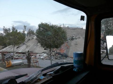 Earthquake flattened house
